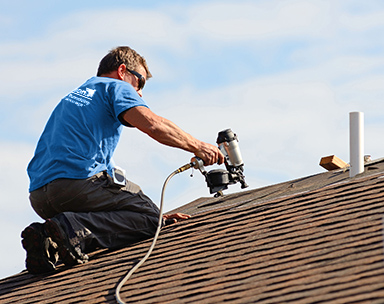 roofing service being performed by roof shingler